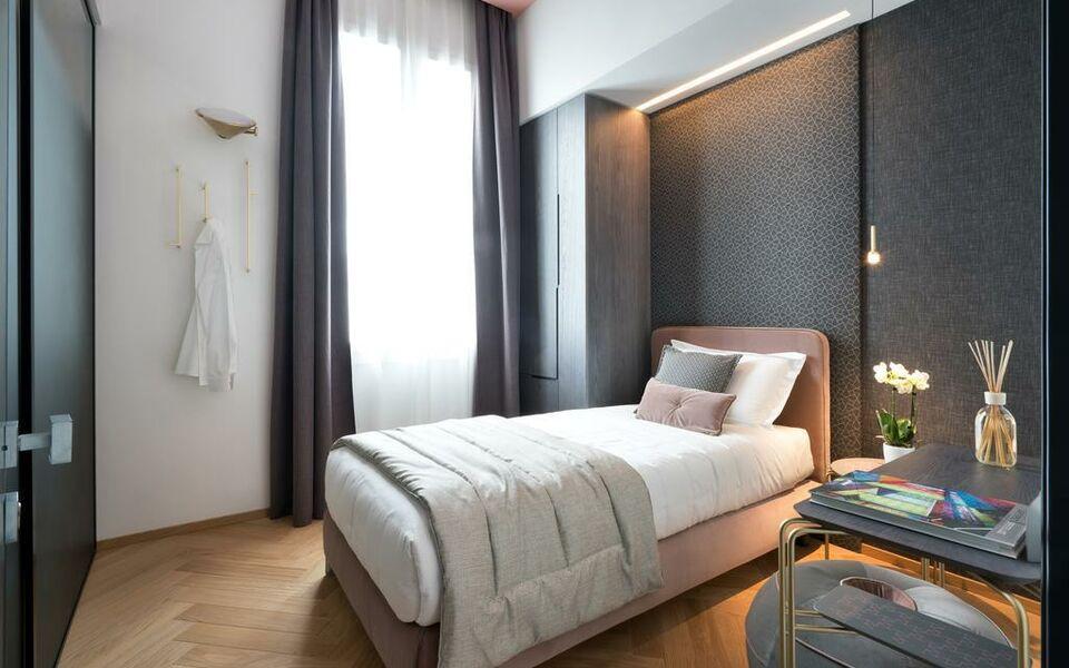 Conti guest house milano italia for Camere hotel design
